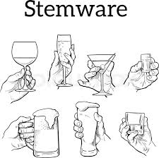 the hand holds a glass with alcohol drinks champagne beer