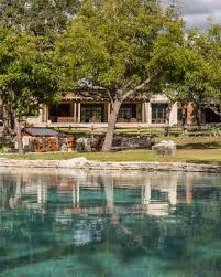 rustic ranch home with stone columns wood beams ranch exposed