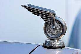 winged wheel ornament photograph by classic visions