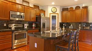 modern kitchen with cherry wood cabinets cherry wood cabinets pros and cons outside the box