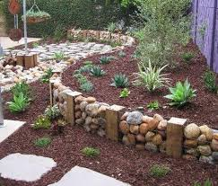 retaining wall made with chicken wire pebbles wood great idea