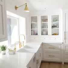 white kitchen faucet dual apron sink with gold gooseneck faucet transitional kitchen
