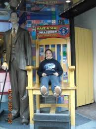 in the chair of the most tallest man in the world picture of