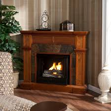Fireplaces Tv Stands by Furniture Brown Wooden Fireplace Tv Stand With White Urns And