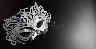 silver mardi gras mask silver mardi gras mask placed on a black background stock photo
