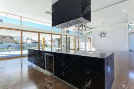 amazing kitchen and living area in new spacious mansion stock
