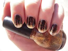 to get this stunning shimmery manicure start by applying a black