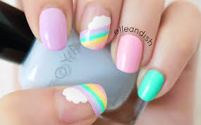 try out this easy gorgeous rainbow cloud nail design