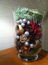 decor made with pine tree branches pine cones silver