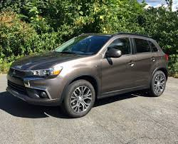 mitsubishi sports car 2016 comparison 2016 mitsubishi outlander sport courts the bargain