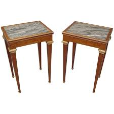 stylish 19th century pair of mahogany with marble top end tables