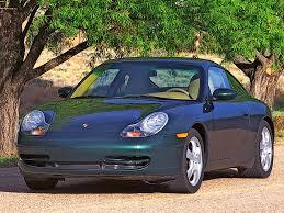 green porsche 911 2001 porsche 911 carrera 4 coupe green front angle 1024x768