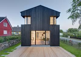 house wieckin by möhring architekten features black walls and deep