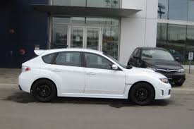 white subaru hatchback white 2008 sti with black oz ultraleggera rims 1 madwhips