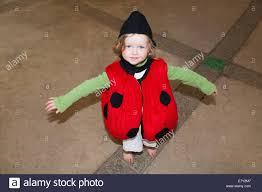 two 2 year old child playing dressing up in fancy costume in