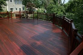 traditional porch deck with mahogany wood deck paint color and