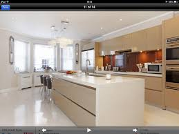 symmetrical wall oven and microwave mirror f f hob in centre