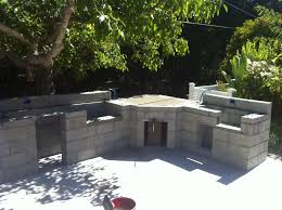 elegant outdoor kitchen designs with having stone cabinet