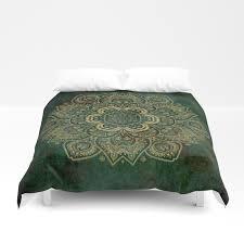 golden flower mandala on dark green duvet cover by lena127 society6