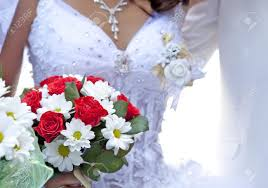 bride holding beautiful red roses wedding flowers bouquet stock