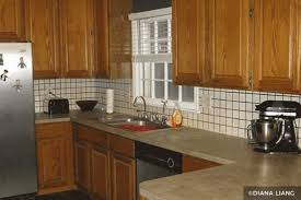 how to paint brown cabinets painting kitchen cabinets before after