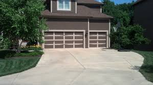 replacing garage door is best home improvement
