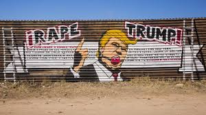 artists use colourful murals to decorate us mexico border wall and a mural of a yelling donald trump painted on the wall that covers 650 miles of