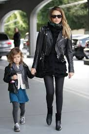 moto style jacket jessica alba black skinnies leggings textured cardigan furry vest