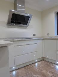 rimini handleless cream led plinth lights pebble kitchens