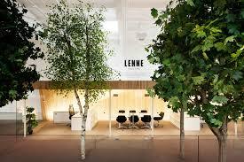 3novices kamp arhitektid creates tree filled office within former