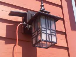 outdoor light fixture with built in outlet outdoor light with gfci outlet digihome with regard to porch light
