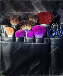 tools for makeup artists brushes scissors and tools of makeup artist in black stock photo