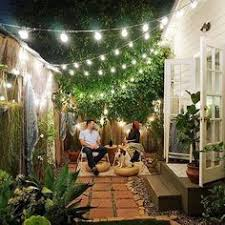 Patio And Garden Ideas The Whole Look Of This Back Garden The Hanging Lights Give A