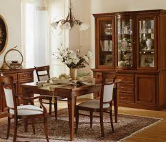 combined kitchen and dining room white wood dining chairs combined with dark wood built in wall