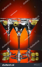 red martini drink martini glass olive inside over red stock photo 53207917
