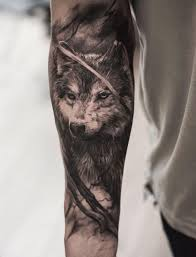 black and gray wolf on arm