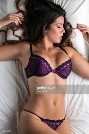 Bed Eyes Woman Eyes Closed In Purple Bra And Panties Laying On Bed Stock
