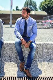 how to wear navy jeans with a white vertical striped dress shirt