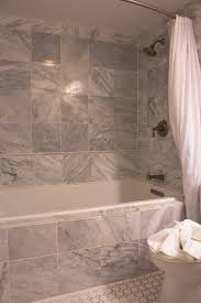 bathroom tub tile ideas small glass window white wood framed door