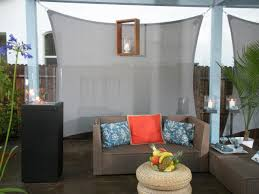 outdoors simple canopy patio with vintage modern furniture under