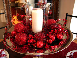 candle display with glass votive red ornaments and christmas