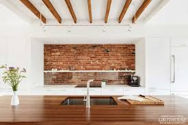 exposed brick kitchen designs with countertops by grothouse