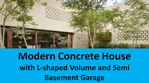 l shaped garage modern concrete house with l shaped volume and semi basement