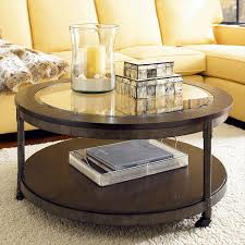 saving small living room spaces with round brown wood coffee table