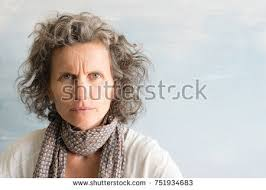 looking with grey hair middle aged woman grey hair frowning stock photo 751934683