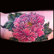 traditional peony flower tattoo on bicep