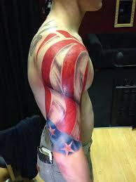 man with patriotic tattoo on right half sleeve in 2017 real photo