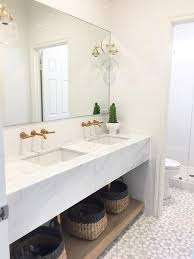Floating Bathroom Vanity by Marble Floating Bath Vanity With Brass Hexagon Mirrors Modern