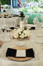 lantern centerpieces ivory gold and black wedding backyard