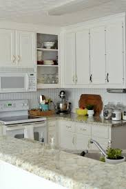 wainscoting backsplash kitchen marble top with white cabinet using wainscoting
